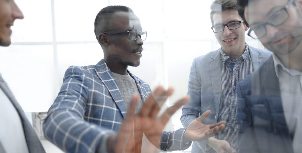 Group of male leaders communicate with influence