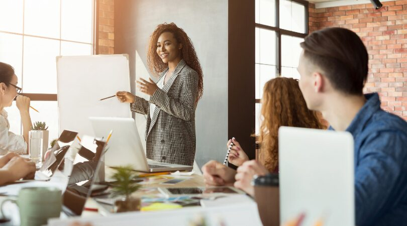 modern-business-woman-teaching-a-table-of-employees
